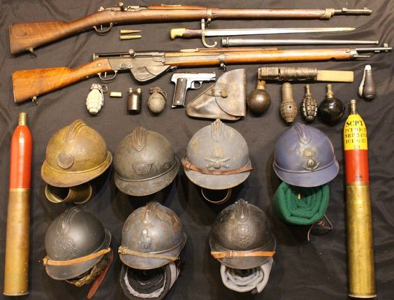 An assortment of French WW1 weaponry • Starting with a Mle 1874 Gras rifle, possibly the M14 model, with its bayonet and both a 8mm Lebel and a 11mm Gras cartridge • Directly underneath is a RSC Mle 1917 semi-automatic rifle •...