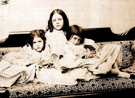 """Alice Liddell (right) with her sisters circa 1859, photographed by Lewis Carroll    """"A long procession of charming little girls (we know today that they were charming from their photographs) skipped through Carroll's life, but none ever took the place of his first love, Alice Liddell. 'I have had some scores of child-friends since your time,' he wrote to her after her marriage, 'but they have been quite a different thing.""""Historian Martin Gardiner"""