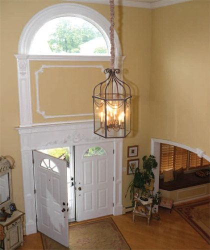 Chandeliers for foyers that flow through the two for 2 story foyer chandelier
