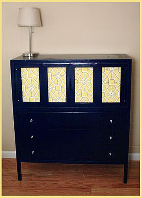 Thrift-store find that we spray painted and spruced up with fabric. Unconventional take on nursery furniture!