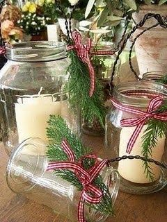 Jar candles. The little evergreen sprigs tied with red and white checked ribbons make an old jelly or pickle jar look like something from Pottery Barn, am I right?!: