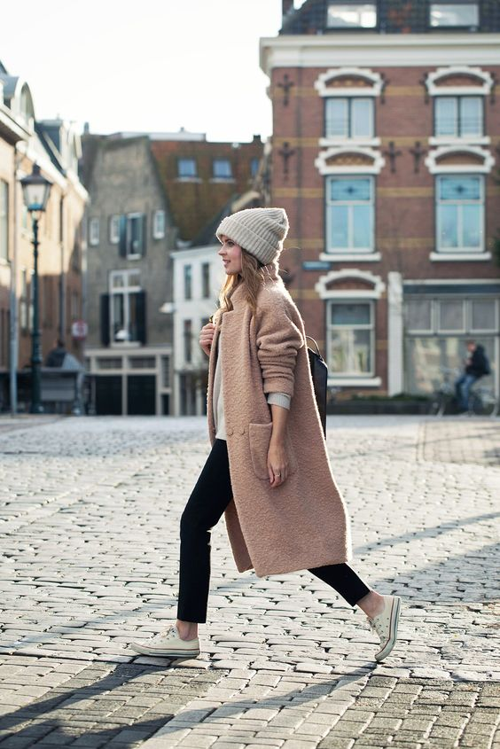 This pale coral Ganni coat looks stylish and chic worn with cropped cigarette trousers and white converse sneakers. Pair a knitted beanie with the look to get that winter feel. Via Christine R. Coat: Ganni, Trousers/Sweater: Zara, Shoes: Converse, Backpack: Loxley England, Beanie: Weekday.