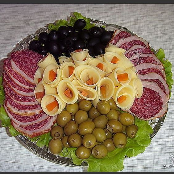 Russian appetizer platter - looks like cheese rolled with something inside to make it look like a flower.  (no directions on this site)