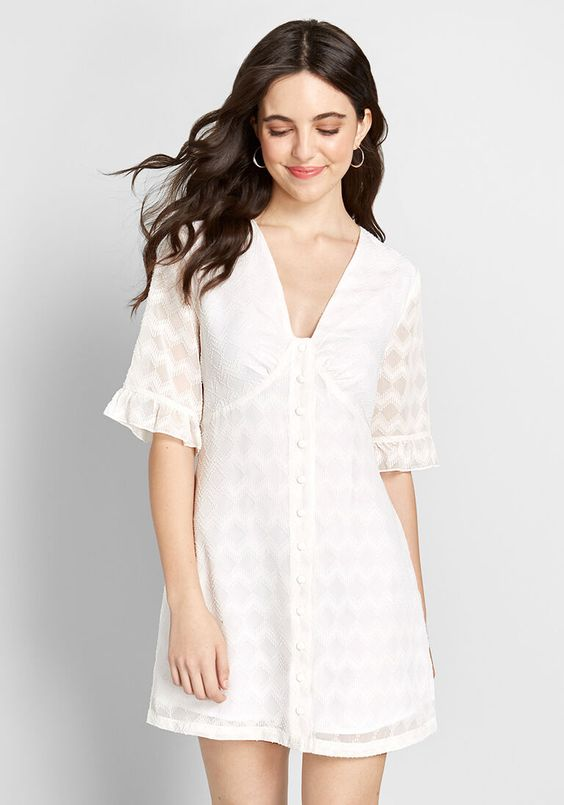 Put your most darling look on display in this white mini dress! Boasting sheer half sleeves, a V-neckline atop button closures, and a textured geometric pattern throughout, this airy A-line from ModCloth makes you the stylish standout at any daytime event