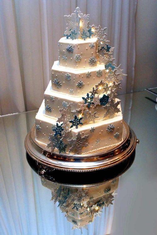 Wedding Cakes by Dianne Rockwell, featuring new-fallen sugar snowflakes on buttercream, sparkling with fairy lights