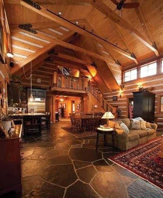 Lovely rustic interior love the slate floors rustic for Rustic cabin flooring