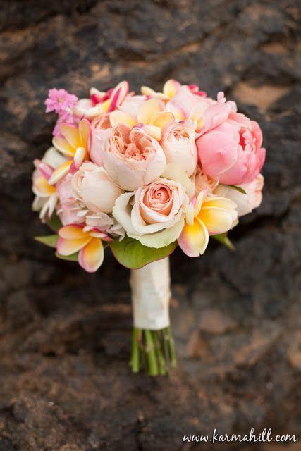 Plumeria and peonies.  Sooo pretty. Maybea hibiscus?  -kendra wedding bouquets plumerias peonies