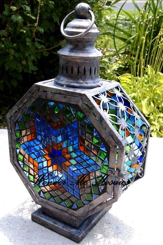 Up for sale is a one-of-a-kind, handmade stained glass mosaic lantern. I have hand cut all of the stained glass tiles (diamonds, triangles and