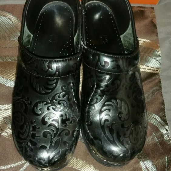 Dansko shoes Black with a silver sheen. Slight scuffing and soles are  worn down but still look very nice. Comes with original  box. Priced accordingly. NO LOWBALLS! Dansko Shoes