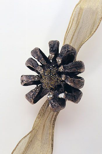 Michele Oka Doner - Pollen (seed corsage), 2001. Bronze with canary and white diamonds, and ribbon.