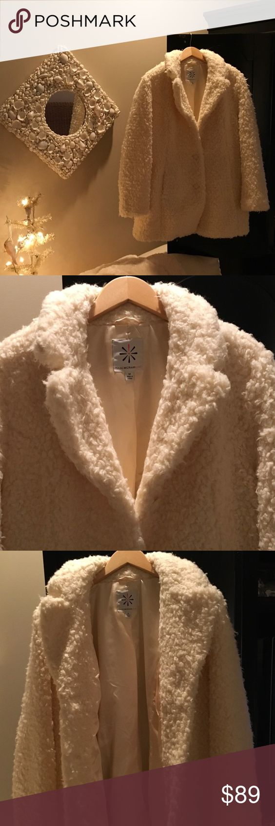 "Isaac Mizrahi Faux Fur Coat Brand new ( came in bag -no tag) Winter Wonderland. 34"" long ,fully lined ,collared, 3 button, side pocket, machine wash, relaxed fit, generous cut.   Cozy and lovely for the season! Isaac Mizrahi Jackets & Coats"
