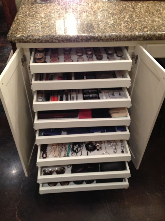 Shallow pullout drawers for makeup, jewelry & sunglasses storage; hidden by cabinet doors. My carpenter told me I was crazy but I love these!