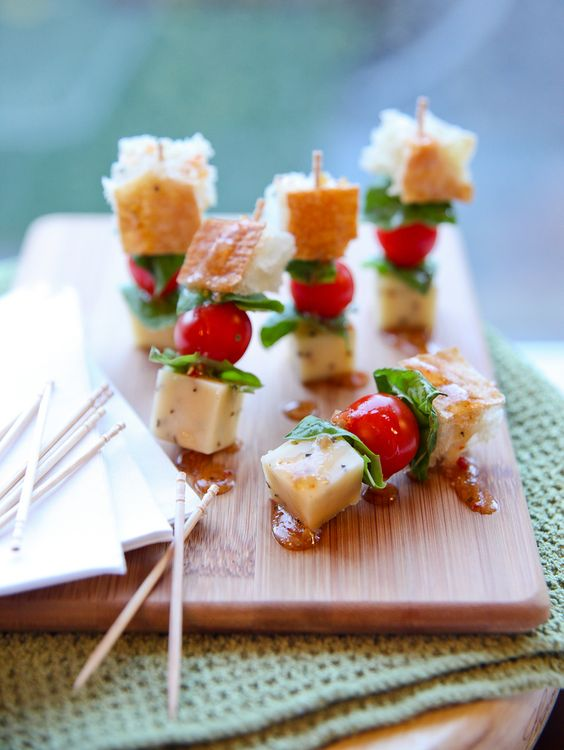 """Panzanella salad skewers......Looking to start your resolution a few days early? Why not serve a well-balanced appetizer option this New Year's Eve! These """"Panzanella Salad Appetizer Bites"""" are super simple to prepare. Imagine a mini salad on-a-stick! A toothpick is skewered a cube of Cracker Barrel Cracked Black Pepper Cheese, fresh basil, grape tomatoes, and a cube [...]"""