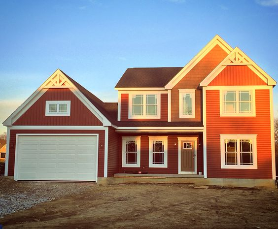 """Building a new home is defiantly an experience. Picking out colors is always difficult without seeing a finished example and it is extremely rewarding when what your vision was pans out to be exactly what you had hoped. 3 siding textures using vertical, horizontal, and """"wood""""shake all with white trim and black roof. We decided on a red craftsmen like style in order to stand out in a community of all beige and tan. #redhouse #craftsmen #colonial #countryliving #newconstruction #rocklandhomes"""