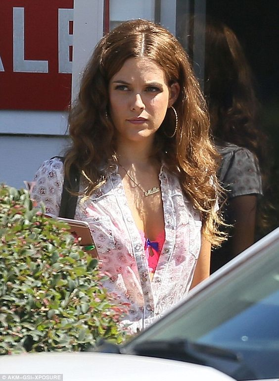 Flashing her cleavage: Riley Keough shows off her assets as she films Logan Lucky with Channing Tatum in Atlanta, Georgia, on Wednesday