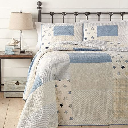 Refresh your master suite or guest room with this lovely cotton quilt, showcasing a country-chic star motif in blue and white.  Prod...