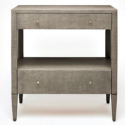 "The unique proportions of the Conrad Double Nightstand are both sensible and modern. This accent furniture's finish is resin-cast from raffia, making it much more durable and refined than the actual woven material. Two drawers provide storage while a middle shelf can be used to display treasures. Minimal brass knobs also heighten this piece""s vintage appeal."