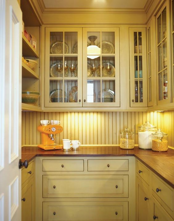 Plain And Fancy Cabinetry In Pantry Color Yellow
