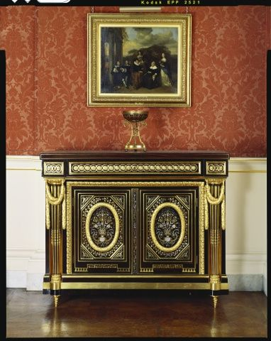 Located 2015 in the Picture Gallery of Buckingham Palace, London, UK. Pair of neo-classical Boulle cabinets by Pierre Garnier c. 1770. Pair of rectangular oak cabinets veneered with ebony & boulle marquetry in brass, pewter & tortoise shell & decorated with elaborate Gilt bronze mounts. Has  2 small and 1 long drawer along frieze above two inset doors. Gilt bronze frieze extends around front & sides. Bought by King George IV (1762-1830) UK in 1819, Uncle of Queen Victoria (1819-1901) UK.