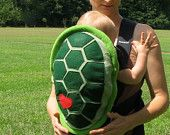 Turtle Shell Baby Carrier Accessory Bjorn Cover with Huge Storage Pocket. $59.00, via Etsy.