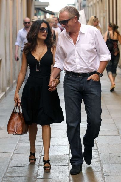 Salma Hayek and her husband Francois-Henri Pinault go for a walk in Venice, Italy.