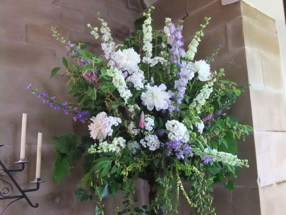 Church pedestal arrangement in white and green with a hint of blue