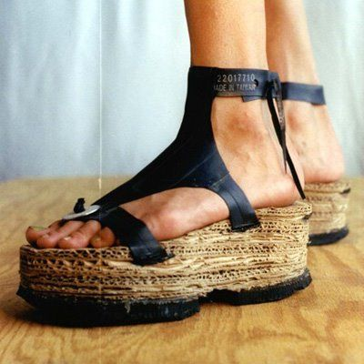 Indie Fashion and Beauty: Recycled DIY Tire Sandals made by Courtney Kessel. These fabulous shoes consist of laminated cardboard platforms with tire tread soles. The upper is all bicycle tire inner tubing and a washer.: