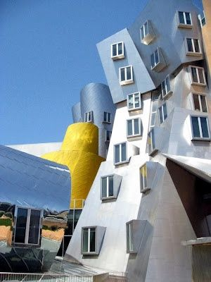 The Frank Gehry building, like an awkwardly assembled children's toy, the…
