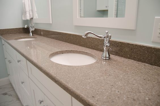 This extra long countertop expands the length of the bathroom. With new Victorian Style hardware, this bathroom remodel is sure to strike up a conversation.