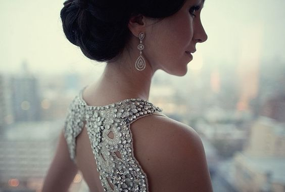 all the pretty details:  ornately beaded back, drop earrings, classic hair