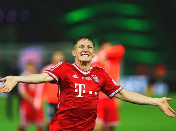 FC Bayern München - DFB-Pokalsieger 2013 #Triple --- Bastian Schweinsteiger of Bayern Muenchen celebrates victory after the DFB Cup Final match between FC Bayern Muenchen and VfB Stuttgart at Olympiastadion on June 1, 2013 in Berlin, Germany. Bayern become the first German team to win the treble of league, cup and European Cup/Champions League.  (Photo by Christof Koepsel/Bongarts/Getty Images)