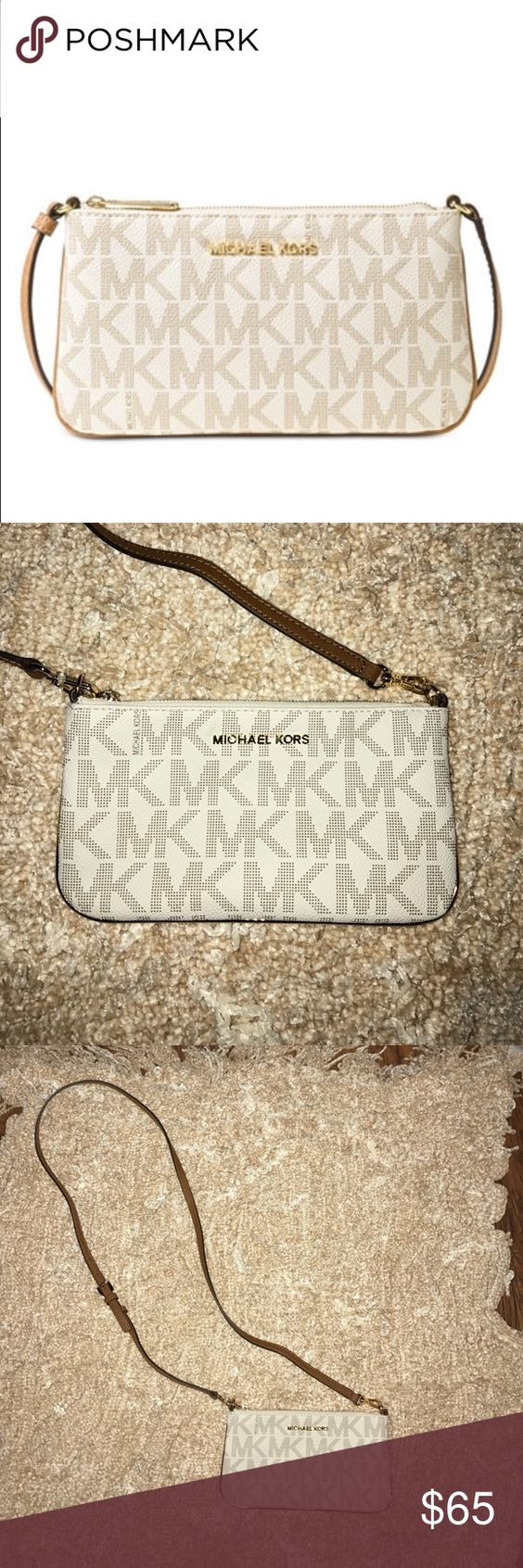 NEVER USED Michael Kors Logo Crossbody MK Vanilla Signature. One large bill compartment and 6 card holders. Zip closure. Exterior feature gold-tone hardware. Adjustable strap MICHAEL Michael Kors Bags Crossbody Bags