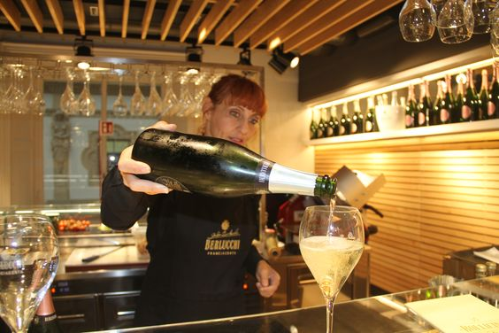 "Sommelier serving Berlucchi Franciacorta wine in ""Le Bollicine Del Duomo"", in the hearth of Milan. #BerlucchiMood"