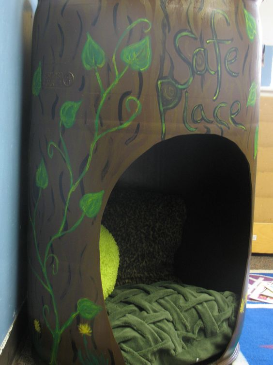 Decided to use a barrel for a safe place this year so it would be a cozy place for one child. My creative co-teacher and I turned it into a tree stump, complete with glow in the dark fireflies and stars on the inside.