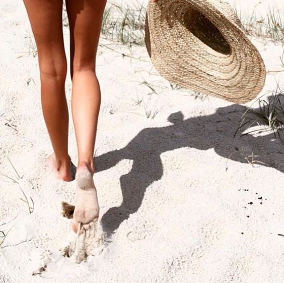 walking down the beach with the most important accessory for a beach day