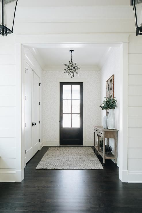 Double Closet Doors In A Cottage Foyer Finished With Oil Rubbed