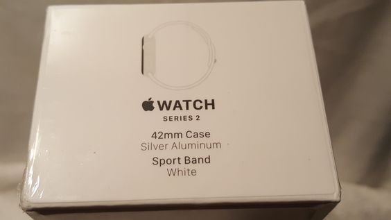New/sealed Apple watch series 2 42mm white sport band, silver aluminum