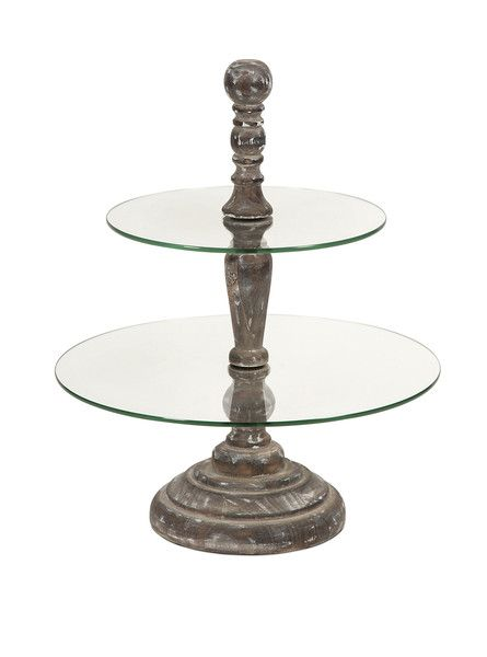 This cake stand has two round tier glass surfaces surrounding a decorative wood finial and base.  A great server for petit fours, cupcakes or hors d'oeuvres.