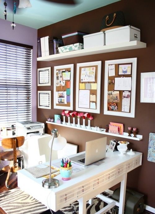 organized office space. love the integrated shelves and bulletin boards... future home office