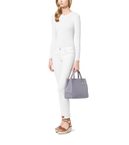 The Anabelle tote is a masterclass in timeless elegance. Crafted from premium pebbled leather with a top handle and adjustable shoulder strap, the structured style fastens with a top-zip closure. Enhanced by iconic logo hardware, this handbag is as practical as it is polished.
