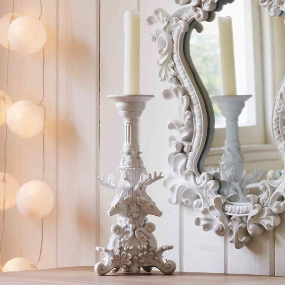 Captivatingly beautiful baroque candle holder featuring an artful white resin deer head design.