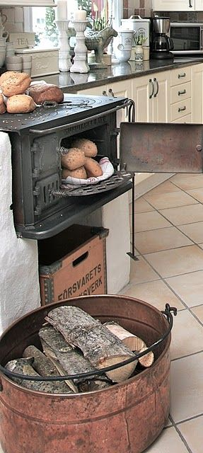 If I owned my own cottage, I would have my kitchen redesigned to included a wood burning stove, for breads.  Maybe not exactly like this. but something that created the hearth and home feeling, with functionality.