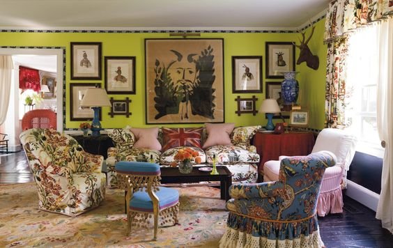 The living room of a home in Long Island's Locust Valley — whose foundation dates to 1668 and whose exterior echoes that of George Washington's Mount Vernon — may be a riot of color and chintz, but it's a riot that feels just right.