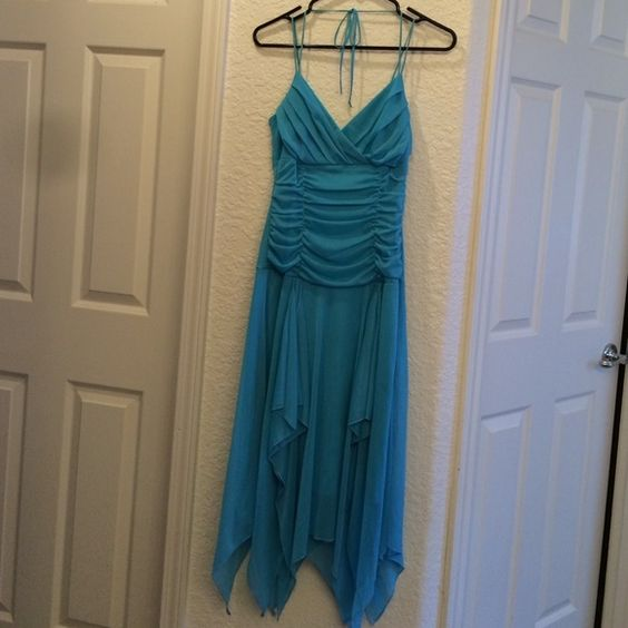 Fun blue dress Fitted top. Flowy bottom. Layered bottom. V-neck. Thin spaghetti and halter strap combo. Worn once. Like new condition. Trixxi Dresses