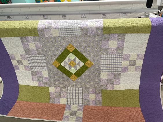A charity quilt for Linus Project. I used a light purple Superior Omni thread. The design quilted edge to edge is Feather Delight. I think it really softens the pattern. Check out our website for easy ordering to finish your quilt! #longarmquilting #charity #quilting #quilt #purple #idahoboutique #quiltingfromeveryangle #superior #thread #feathers #quiltingismytherapy