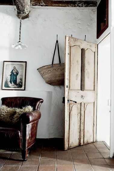 Rustic entrance to a farmhouse in Provence. European Farmhouse and French Country Decorating Style Photos. #rusticdecor #provence #europeanfarmhouse #interior