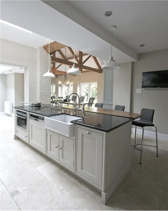 For a clean and contemporary kitchen, try Farrow & Ball Shaded White and Stony Ground