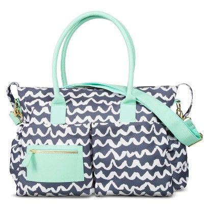 Meet every new mom's favorite accessory: the Oh Joy! Tote Diaper Bag. Designed by blogger and designer Joy Cho, this diaper bag tote lets you take Joy's fun scallop pattern on the go. Plus, it has tons of compartments and pockets for organization for carrying everything a new mom needs, including a matching changing mat. Tote this baby diaper bag around in comfort with 2 sturdy bail handles and an adjustable shoulder strap. Coordinating changing pad included.