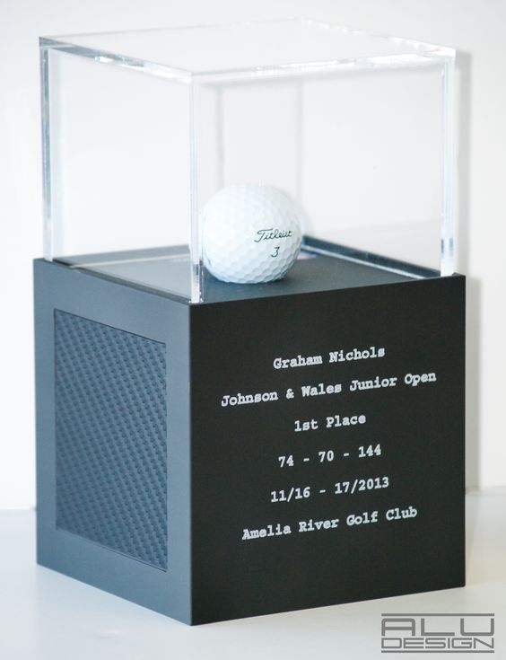 1st Place Trophy Cases. Luxury Modern Golf Ball Display Cases Anodized Graphite Aluminum with Black Carbon Fiber look. Modern Golf Ball Display. Add your logo, HOLE IN ONE LOW ROUND COURSE RECORD or Trophy, Custom Design MADE IN USA by ALU DESIGN Golfball Vitrine Golfball Schaukasten Golfregal