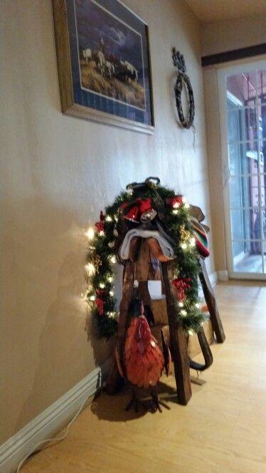 Horseshoe  Xmas weath on  our saddle stand .
